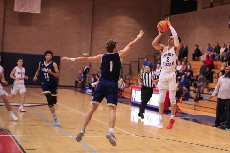 Junior Chase Tucker (3) shooting at a game versus Whitefield