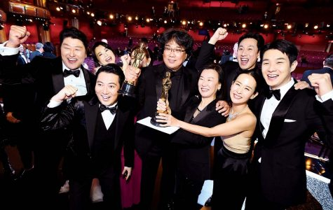 Parasite cast and producers holding their awards at the 2020 Oscars
