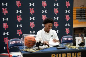 Peterson signs his letter of intent to Purdue University Fort Wayne at Mount Pisgah's signing day event on November 11