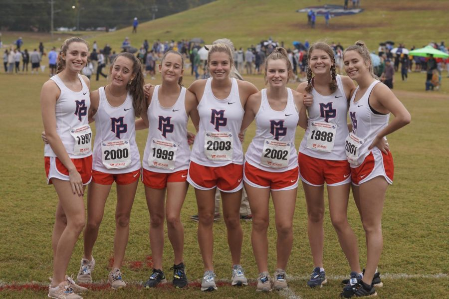 Staff writer Jenna Culpepper (second from right) with her Varisty cross country team at their state meet